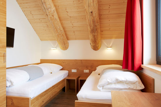 Spacious chalet bedroom with separate single beds, especially adequate for the kids