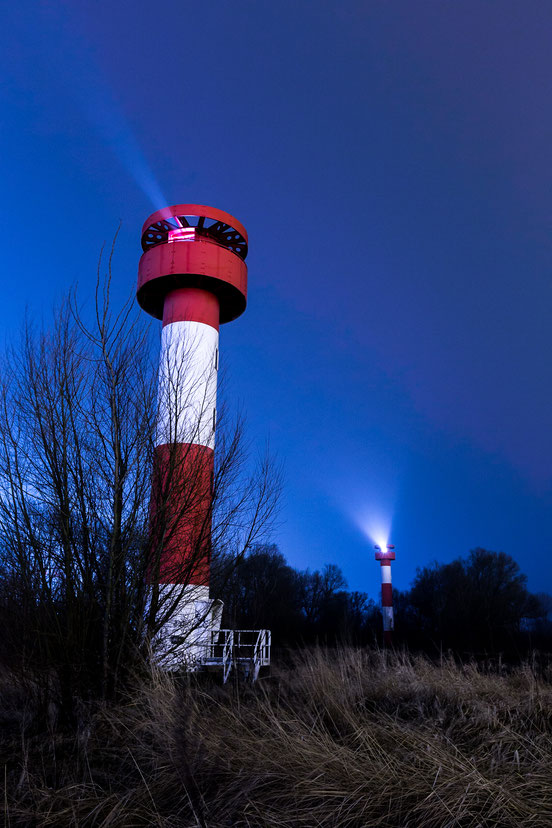 Two lighthouses at night near Container terminal Altenwerder, Hamburg