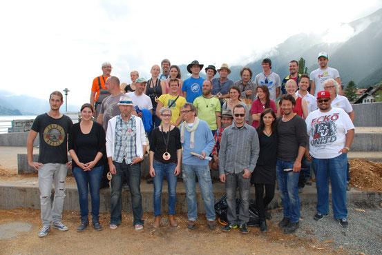 Holzbildhauer und Organisationskomitee Symposium 2014