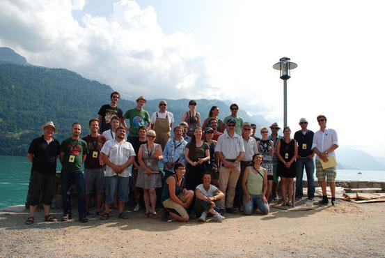 Holzbildhauer und Organisationskomitee Symposium 2013