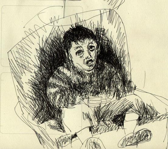 little boy in big chair