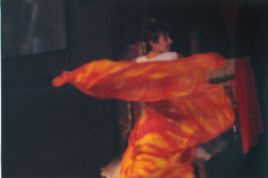Woman dancing with a silk that looks like fire