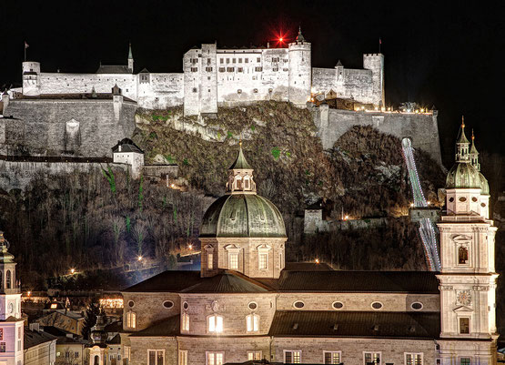 The Hohensalzburg Fortress and the Salzburg Cathedral at night.