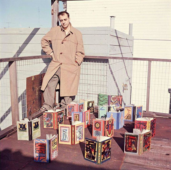 San Francisco poet Kenneth Patchen in 1957 with a collection of his painted books. The photograph was taken by the late photographer Harry Redl on the rooftop of his apartment house in San Francisco.