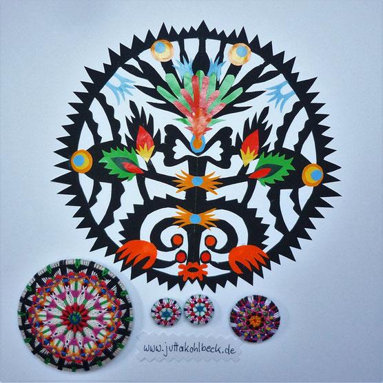 Das Bild zeigt dekorativen Scherenschnitt und die dazu passenden handgewickelten Posamentenknöpfe