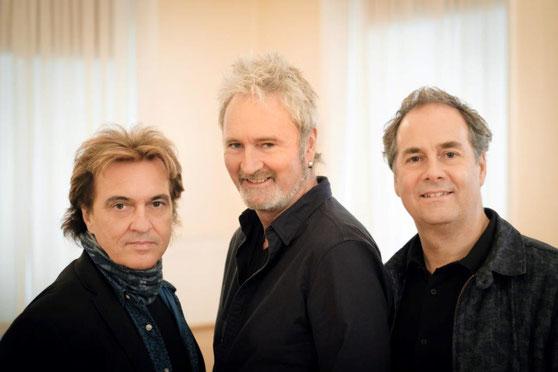 Die drei Frontm3n: Peter Howarth, Pete Lincoln, Mick Wilson (v. l.)