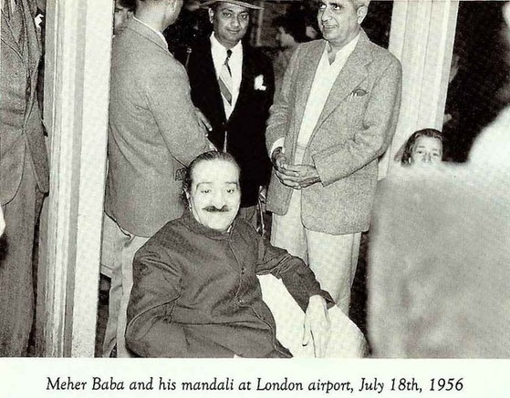 Eruch Jessawala, Nilu Godse &  Adi K. Irani standing behind Meher Baba whilst waiting to depart for the USA