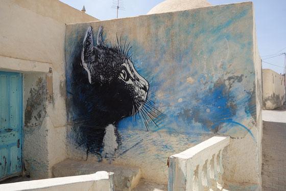 チュニジアの壁に描かれた作品。Wikipediaより。