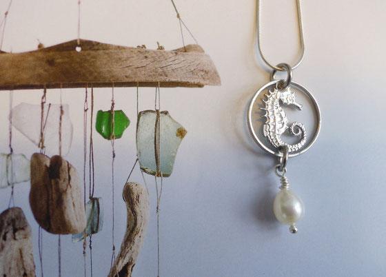 Münzsägewerk Katrin Thull   Singapur - Seepferdchen mit Stein