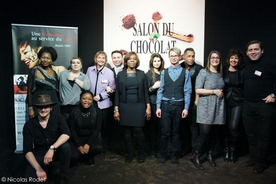 Direction, professeurs et élèves réunis sur le podium du 1er Salon du Chocolat à Bruxelles