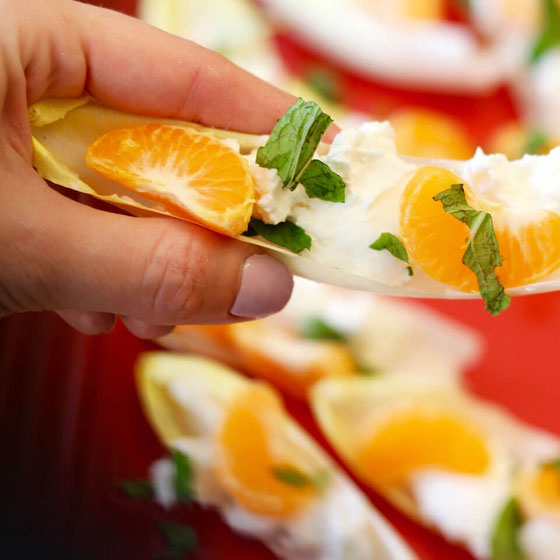 Looking for an easy appetizer? Get your next party started with these ready-in-minutes endive boats. This mandarin orange recipe also works great as an afternoon snack. #easyappetizers #healthyappetizer #appetizerrecipes #endiveappetizers #glutenfree