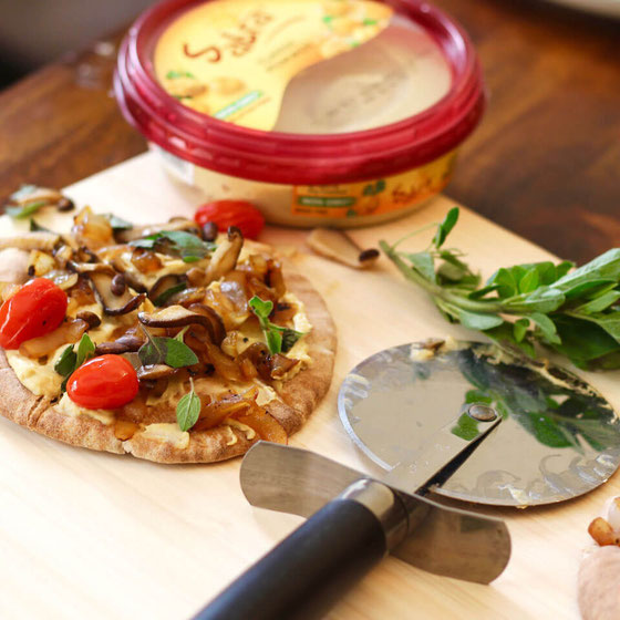 This hummus pizza is yum. Guests will love the vegan pizza recipe! Why? It's a pizza without tomato sauce & a pizza without cheese! It will quickly become one of your fave pizza recipes. #pizza #hummus #veganrecipes #plantbased #hummusrecipe #pizzarecipe