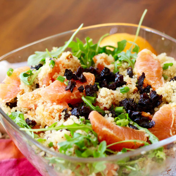 Looking for healthy salad recipes? This Citrus Quinoa Salad with Prunes is perfect for summer and is loaded with arugula and fruit!