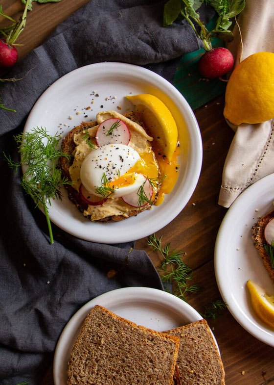 This Egg & Veggie Topped Hummus Toast with Radish & Dill is the best easy breakfast idea anybody can make! It's a great vegetarian brunch idea you can enjoy for lunch or dinner! @sabradips #ad #amyseatlist #hummustoast #easybreakfastides #easybrunchideas