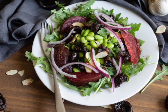 This Vegan Mediterranean @Sunsweet Prune Salad with Beets, Almonds, and Edamame is a unique salad recipe. It's a high-fiber meal idea that tastes just as good as it looks. #ad #ToFeelGood #SunsweetStrong  #mediterraneandiet #vegansaladrecipes #prunesalad
