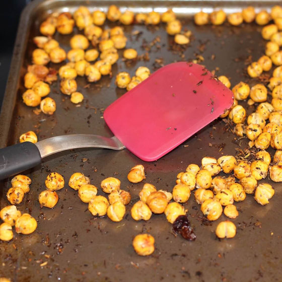 Whip up this healthy and easy snack in your oven! These Spiced Roasted Chickpeas are crunchy and a great salad topper! They're Weight Watchers friendly, too!