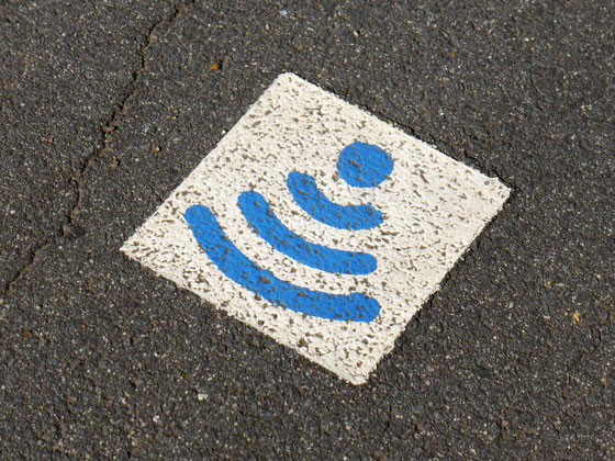 A sign on the footpath indicating free Wi-Fi, in Longford, Tasmania