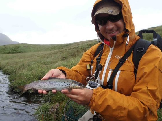 Elmar with the first trout of what was a very difficult day for casting a line in!