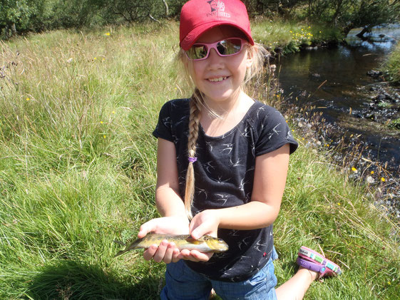 Maddy at the burn with her very first ever wild brownie on the fly!