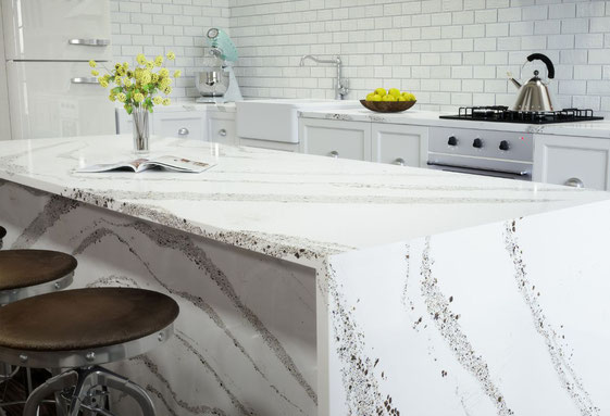 Kitchen with Cambria Annicca quartz countertops, white cabinets, and white subway tile backsplash.