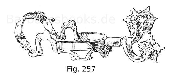 Fig. 257. Schwerer Kutschenreitersporn aus Messing mit drei Hälsen und sternförmigen Rädern. Deutsch. 17. Jahrhundert.