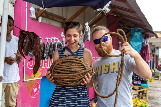 "Couple on vacation at local market holding tobacco called ""Grabba"" at an excursion in Montego Bay, Jamaica"