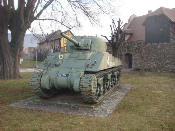 The western entrance to the village of Kientzheim with the M4 Sherman tank of the 5th French Armored Division. This M4 was knocked out on Dec. 18, 1944 after winning a shootout with a German Panther Tank.