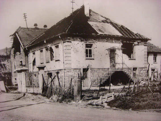 "8 Route de Vin - site of the German CP, after the battle. On the right side of the photo was Walter Laich, armed with a Panzerfaust and knocked out Camille Girard's M4 Sherman Tank ""Fort de France"". (Photo courtesy Aimé Haubtmann)"