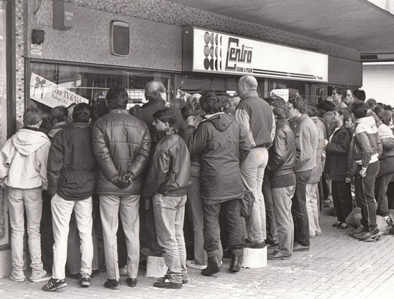 1987: before the internet, WiFi, mobile phones, smart phones, digital T.V., digital radio, SKY Sports satellite T.V. etc these hardy Rovers fans gather around one of the only satellite T.V.'s in town to watch the match through a town centre shop window.