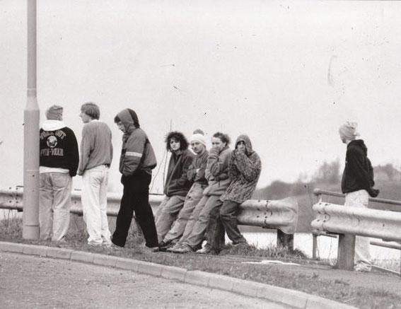 1990: Party goers waiting for a lift at the Whitebirk roundabout in Blackburn.