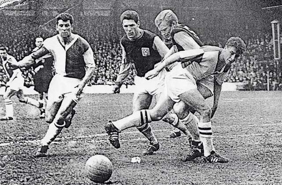 West Ham v Rovers. John Byrom tussles with Bobby Moore.