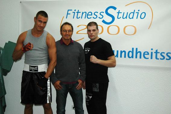 Box-Profi Kevin Kotzian, Studio-Besitzer Joachim Pasucha und Trainer Mike Kaul (v.l.).