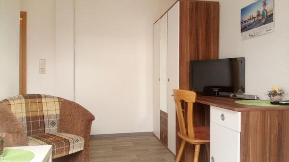 Wohnbereich in einem Einzelzimmer-Apartment
