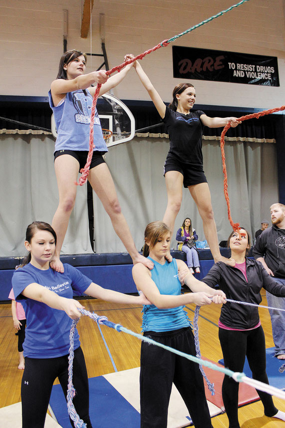 Members of the Ski Bellevue Waterskiing Team conducted dryland practice drills in the Bellevue Elementary gymnasium over the weekend, utilizing ropes attached the the walls. Above, Makaela O'Donnell and Isabella Penniston balance on the shoulders of Lexy
