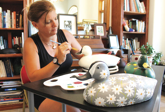 Shannon Witt works on one of her many duck decoy creations at her home south of Bellevue,