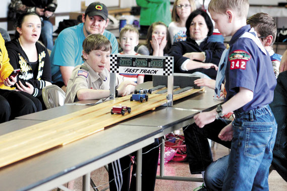 Scouts, parents, friends and relatives gathered around the Pinewood Derby track at the Bellevue American Legion Post last week to get a close-up look at all the racing action.