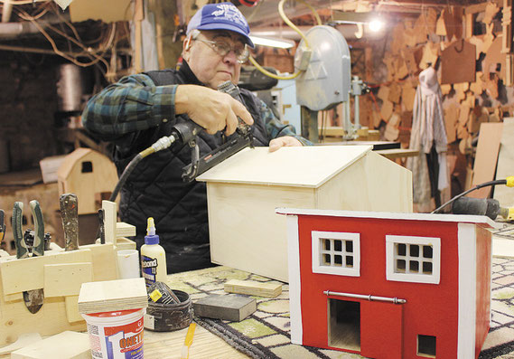 VInce Kilburg of Vince's Toy Shop in rural Bellevue works on a toy barn for a Christmas order after completing a toy poultry shed for another family.