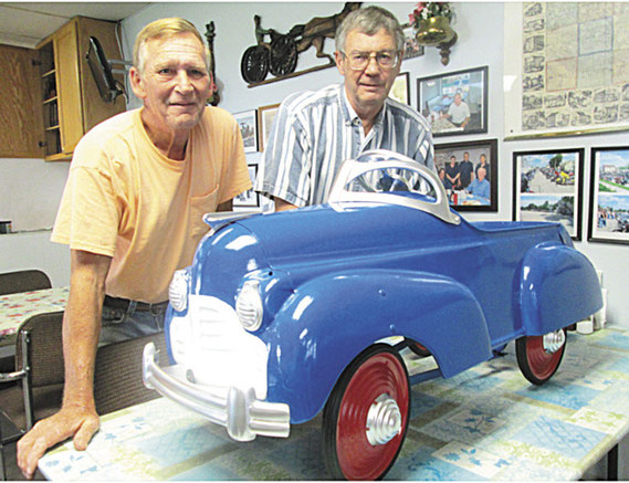 What's old is new again. Milton Cornelius, left, with Eldon Hoerschelman at the Andrew Café and the restored 1941 Murray Steelcraft model of a Chrysler pedal car.