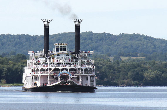 The massive steamboat known as the American Queen, with 370 passengers on board, rolled down the Mississippi River from Dubuque to Bellevue last Tuesday afternoon to lock through on its nine-day journey to the Port of St. Louis, Missouri.