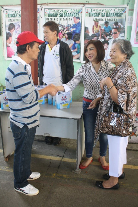 Taken during the conduct of Lingap sa Barangay Program. The  Honorable City Mayor Agnes D. Tolentino gladly greets / handshakes a member of a senior citizen during the milk distribution.