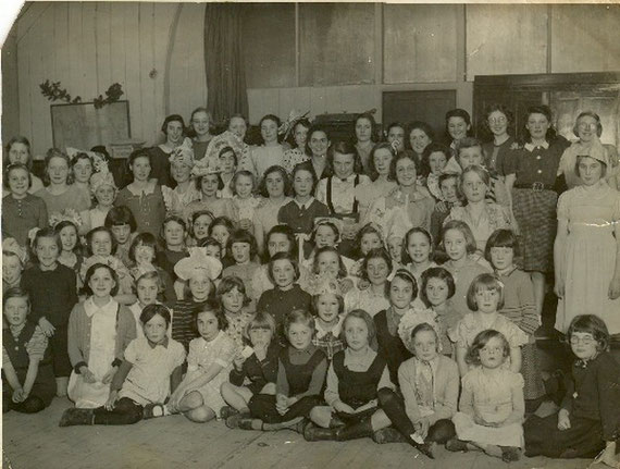 Evacuated families from Hartfield Crescent School dressed for a party
