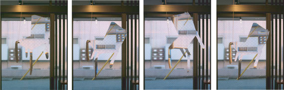 instllation view of 'lie' moving  /  2003  aclyric renz sheet, spring, moter