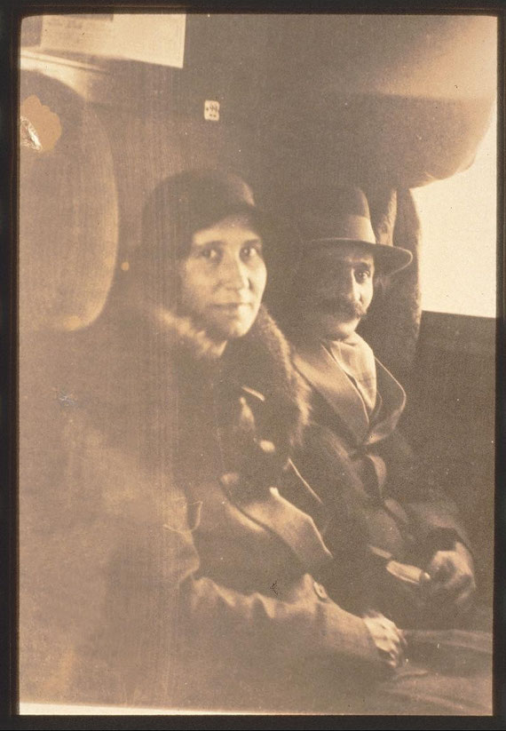 Meher Baba with Enid Corfe on a train in England - April 1932