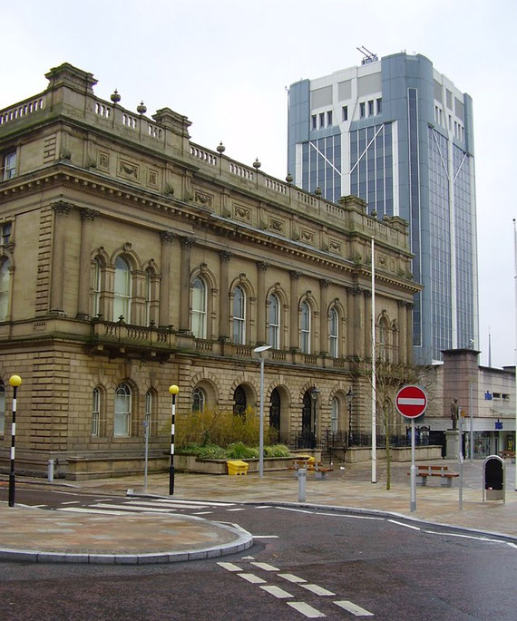 The Italianate 19th-century town hall and its 1960s counterpart—the reclad new town hall