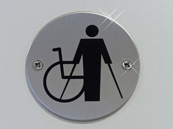Foto: Illustration eines Rollstuhls und eines Menschen der auf Krücken steht.