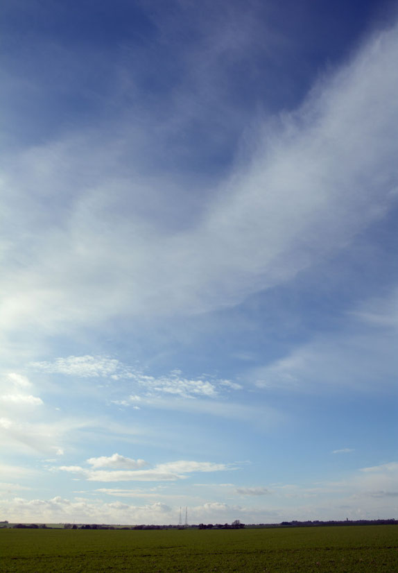 """Big sky II. The """"Three Sisters' (now only two) radar masts above Dover. Brilliant sun and biting wind."""