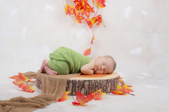 newborn in costume and with flowers