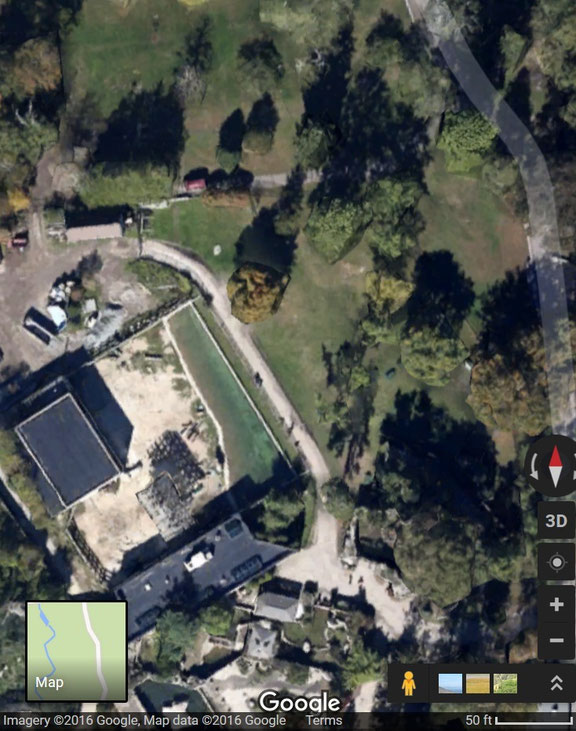 This aerial view of the exhibit shows the barn, yard, and water feature.