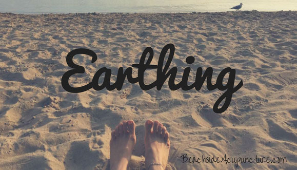 bare feet on beach earthing