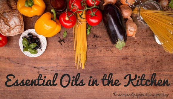 """Essential Oils in the Kitchen"" over cutting board with fresh food"